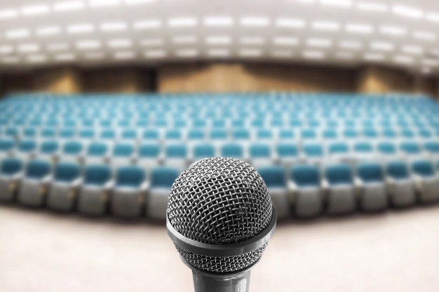 microphone-voice-speaker-blur-photo-empty-seminar-room_101276-13
